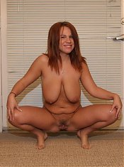 Redhead milf Alyssa West takes her clothes off and shows off her big jugs and shaved pussy in this hot solo